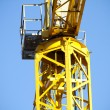 Yellow crane, blue sky - Stock Photo