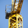 Yellow Crane against Blue Sky , tower with details - Stock Photo