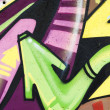 Colorful Graffiti wall urban art hip hop background, arrows - Stock Photo