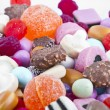 Many candy on white background.Fruit snacks - Stock Photo