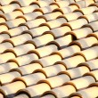 Stock Photo: New orange roof tiles close up detail