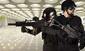 Police against terrorism, two soldiers at an airport — Stock Photo