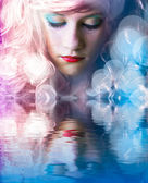 Sweet teen with colored hair, light effects in the water reflect — Stock Photo