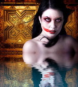 Woman vampire with blood in his mouth. Gothic Image halloween ov — Stock Photo