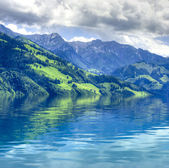 Swiss landscape. Green mountains in water reflection. Ecology — Stock Photo