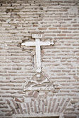 Stone cross on the wall of a church, Spain — Stock Photo