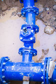 Blue pipe in the street damaged, repair — Stock Photo