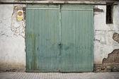Old door in old street of shops — ストック写真