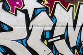 Segment of graffiti wall background, urban street grunge art des — Stock Photo