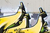 Amazing yellow grafitti — Stock Photo