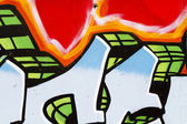 Graffiti on wall, multi colored spray — Stock Photo