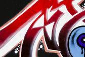 Red Bright Graffiti on Brick , arrow designs — Stock Photo