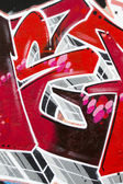 Red background picture of urban graffiti wall — Stock Photo