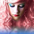 Pink haired fairy girl in water reflection - Stock Photo