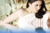 Musa Greek mythology. Female with white veil, reliefs and sculpt — Stock Photo