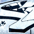 Graffiti over old dirty wall, urban hip hop background Gray text — Stockfoto