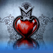 Red heart tattoo on blue wall with water reflections — Stock Photo