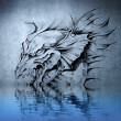 Aggressive fantasy Dragon tattoo on blue wall reflections in the — Stock Photo