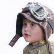 A little cute baby dreams of becoming a pilot. Pilot outfit, hat — Stock Photo