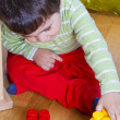 Little baby boy (2 years old) playing with toy blocks. Funny edu - Stock Photo