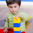 Little baby boy (2 years old) playing with toy blocks. Funny edu — Stock Photo #10418428