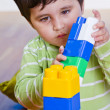 European boy playing with plastic colorful blocks — Stock Photo