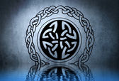 Celtic tattoo drawing on blue wall with water reflections — Stock Photo