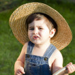 Boy with straw hat, a young outfielder playing with a hose — Stock Photo