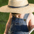 A boy with straw hat, a young gardener enjoying the spring — Stock Photo