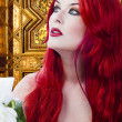 Stock Photo: The beautiful young woman red haired in mysterious medieval room