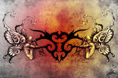 Tattoo kunst ontwerp, tribal met twee nimfen aan elke kant — Stockfoto