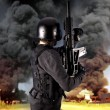 Explosion in an industry, armed police wearing bulletproof vests - Stockfoto