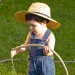 Stock Photo: Little baby boy gardener playing joyful
