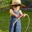 Little baby boy gardener playing with his back to the camera — Stock Photo