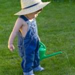 Little baby boy gardener playing very professionally — Stock Photo