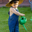 Little baby boy gardener playing in his front yard — ストック写真
