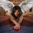 Apocalyptic female angel lying in the street with bloody hands — Stock Photo