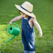 Little baby gardener lost in the moment - Stock Photo