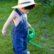 Little baby gardener lost in his task at hand — Stock Photo