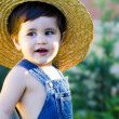Little baby gardener smiling — Stock Photo
