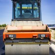 Compactor at asphalt pavement works (road repairing) - Stock Photo