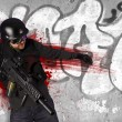 Assault troops, soldier wounded in action, grafitti background - Stock Photo
