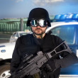 Armed man in protective cask with machine gun. Police — Stock Photo