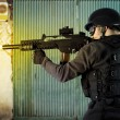 Stock Photo: Street Assault, riot police firing his submachine gun