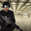 Defense against terrorism, a soldier at an airport — Stock Photo #8665549