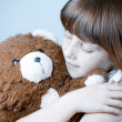 Beautiful redhead girl hugs a teddy bear. — Stock Photo #8666428