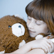 Beautiful redhead girl hugs a teddy bear. — Stock Photo #8666627