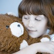 Beautiful redhead girl hugs a teddy bear. — Stock Photo #8666691