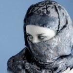 Arab woman wearing veil, cold light — Stock Photo #8667037