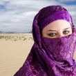 Woman dressed in Arab costume, desert in the background — Stock Photo #8667623